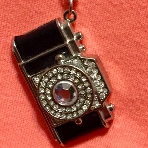 A camera w/ leather and rhinestones necklace